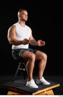 Grigory  1 camo shorts dressed sitting sports white sneakers white tank top whole body 0014.jpg